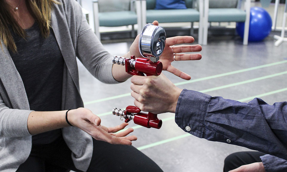 Grip strength machine at Surrey Neuroplasticity Clinic